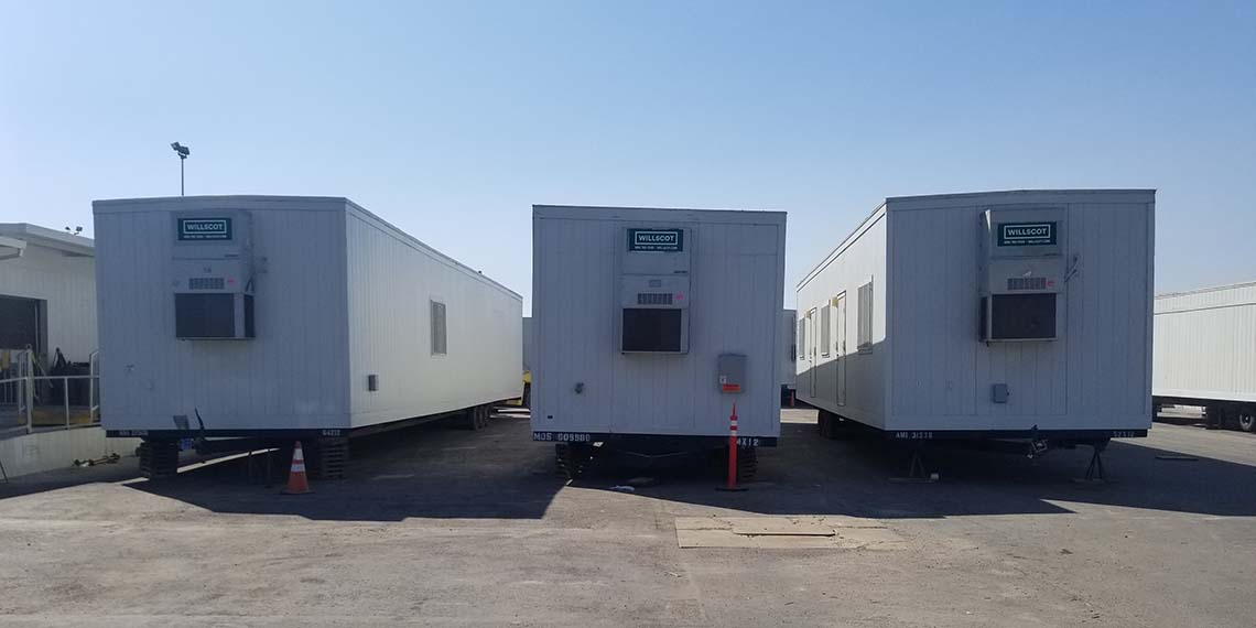 three mobile offices lined up at the WillScot Los Angeles, CA yard