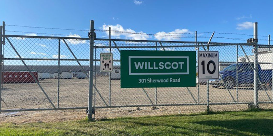 the WillScot sign hanging off the front gate of WillScot Regina office