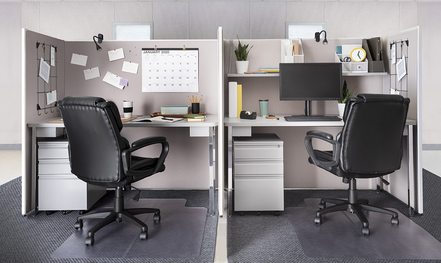Furnished Basic level cubicles containing office supplies